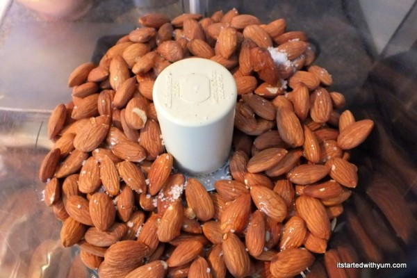 Almonds in food processor with honey and salt
